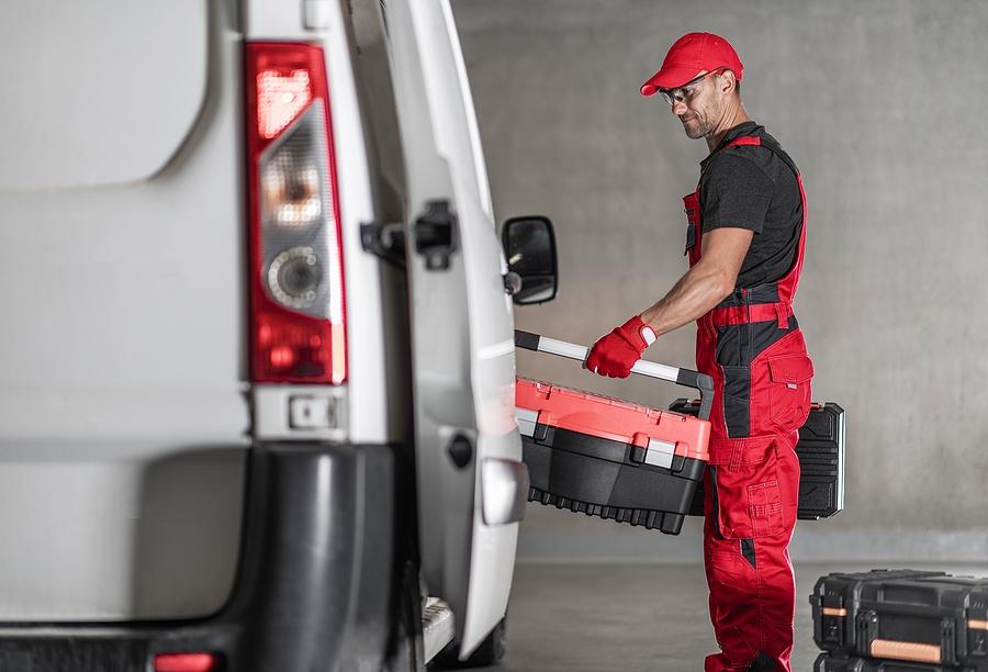 man loads van with tools