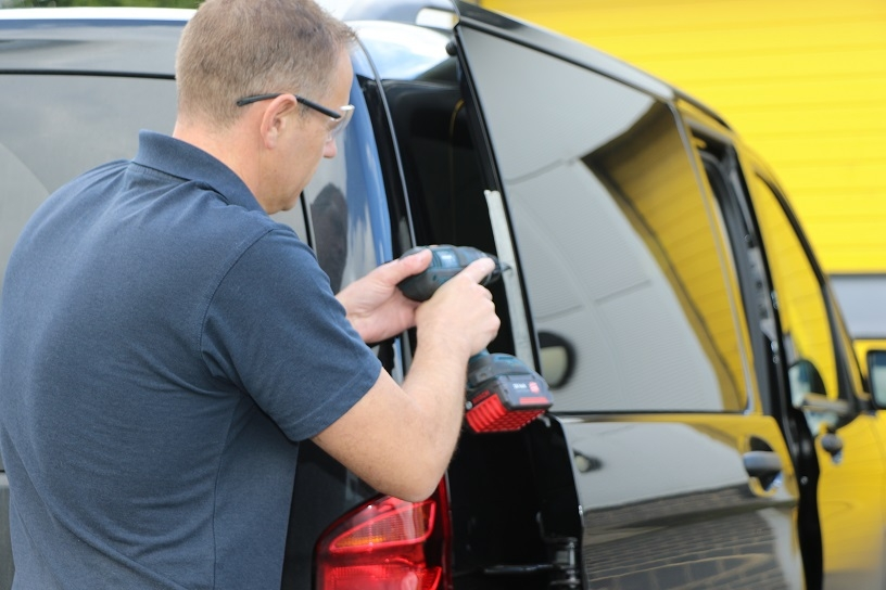 Installing a dead lock into a trade van.